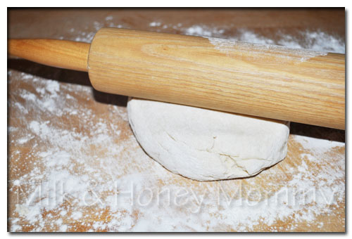 rolling out dough for buttermilk biscuits