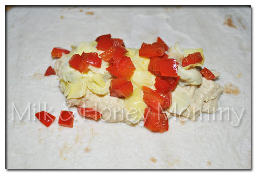 roasted red peppers on hummus